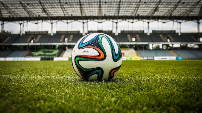 multicolored-soccer-ball-on-green-field-47730